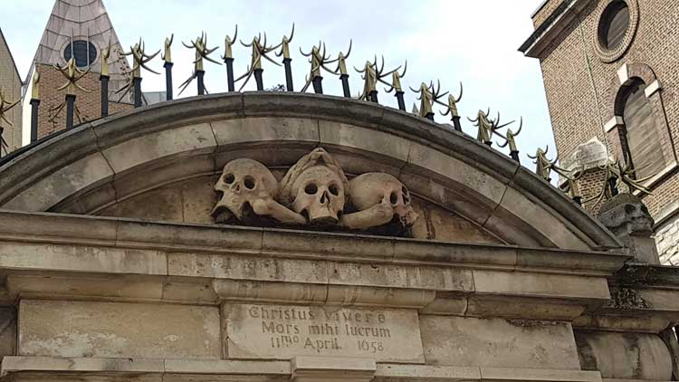 The stone skulls outside St Olave's Church.