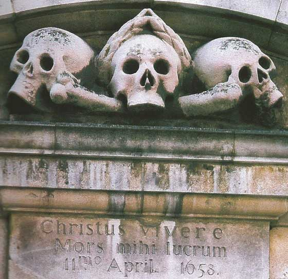 The stone skulls on the gate of St Ghastly Grim.